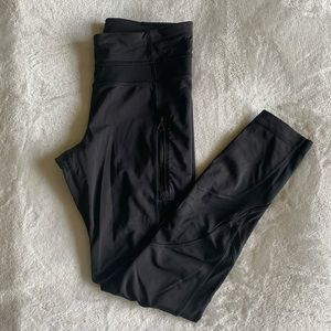 Lululemon black with mesh and zipper pants, size 4